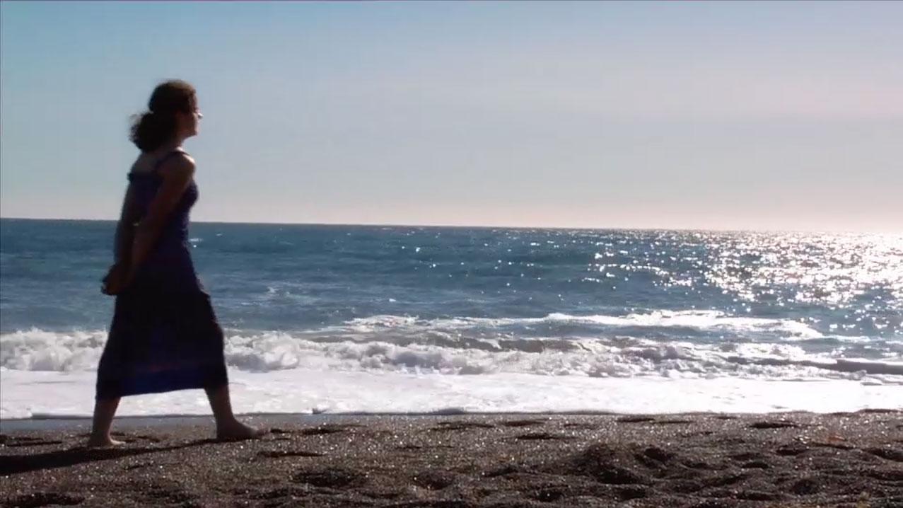 1.Sarah walks on the beach.