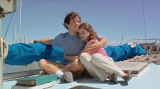 Lounging on a sail boat, Sarah hugs her brother, Sam.